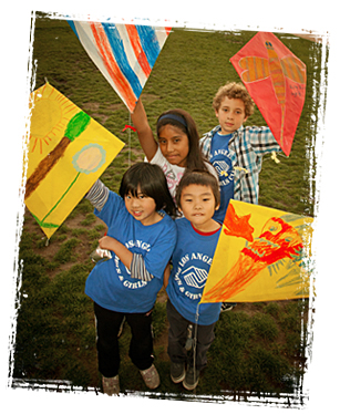 Children playing with hand-made kites at the Los Angeles Boys & Girls Club