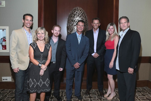 Speedo associates pose with former New York Yankees player and current Los Angeles Dodgers Manager, Don Mattingly, of Mattingly Charities and Manager of the LA Dodgers. Pictured from left to right: Brian Basye, Director of Sports Marketing and Sales; Dianne Jefferies, VP of Sourcing and Production; Scott Schneider, HR Manager; Don Mattingly; Jim Gerson; Lisa Connaghan, HR Manager; Michael Cox, VP of Planning and Forecasting.